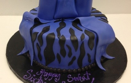 Sweet 16 with A Zebra Print and Oversized Purple Bow.Purple Teenager Fondant Icing.