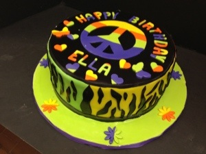 Peace ,Love And Cake Is The Motto At Millers,Tie Dye With A Funky Animal Print On The Sides.Cool Cake For Your Teenager ,That Is Driving You Crazy ,But You Still Love.