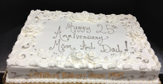 Simple Yet Elegant Full Sheet Wedding Anniversary .25th Silver Anniversary Full Sheet Cake Serves 100,Decorated With All White Roses Throughout With Silver Piping Scroll Work Along The Borders And Sides.Understated And Will Not Break The Bank.