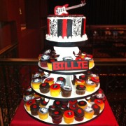 "A Rock N Roll Cupcake Tree With A Guitar Topper Cake And ""Rock On "" Themed Cupcakes You May Also Like"